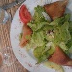 Salad with pockets filled with cheese and tomatoes.