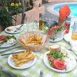 Anne's chips and Greek salad washed down with Athos beer make a fine lunch