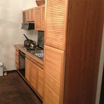 Kitchen with freezer, fridge, kettle, stove