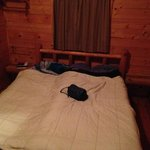 Bed in two room cabin.