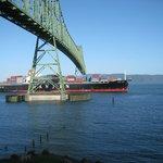Ship passing under Astoria bridge