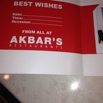 inside the photo card that the photo was taken by akbars staff