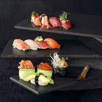 Our choice of nigiri; Flamed salmon, king crab, tuna tataki, beef teriyaki with foie gras.