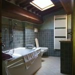 upstairs bedroom, tub, two sinks, adjustable skylight