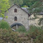 See the old water mill across the river