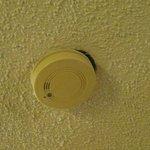 hole by smoke alarm