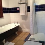 Walberswick room - antique roll top bath in an traditional bathroom