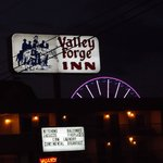 Valley Forge Inn sign and sky wheel in the background