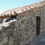 Tiled roof and rustic stonework