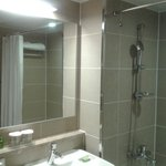 Bathroom is drab & dull, but it is very clean.