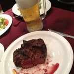 Ice-cold draft beer and filet mignon
