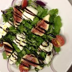 Fig and buffalo mozz on a bed of rocket with balsamic glaze