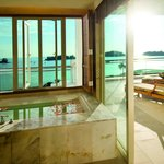 A soothing bubble bath at the open-concept bathroom complement your stay at The Danna Langkawi