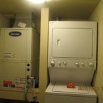 Washer/dryer, furnace and the room is air conditioned as well.