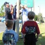 Flag raising ceremony at the Quality Inn