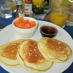 Delcious pancakes with fresh fruit and fruit juices from the orchards.