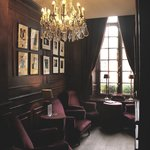 """Small sitting area adjacent to bar sitting room, covered with photos of """"personages"""""""