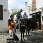 locals on horseback having a beer