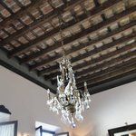 Exposed wooden ceiling with chandelier