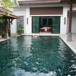Pool and master bedroom in the background