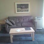 plain living area with vented a/c unit