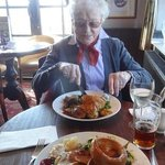 Mother, aged 90, tucking in to a giant-sized 'child's portion'.