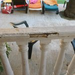 THE ROTTEN BROKEN BALCONY WHICH COULD HAVE CUT  THE FACE OF THE KIDS