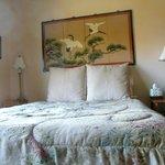 Jade suite front room queen bed with beautiful wall screen