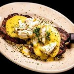 Katy's Medallions - $30  Filet medallions topped with hollandaise sauce and crabmeat
