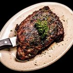 Rib Eye - $32  16 ounce beautifully marbled center cut steak, grilled to temperature