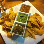 Appetizers of chips and three excellent types of homemade salsa.
