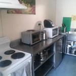 Well equipped clean kitchen and dining room
