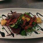Scallops with chorizo, balsamic dressing, mixed leaf salad.
