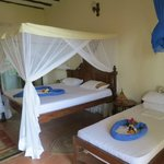 Example of Arabian Nights Hotel ocean view room with an extra  bed