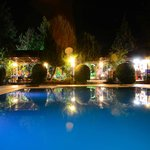 View at night across the swimming pool