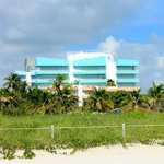 View of Ocean Drive building from beach. Public park in foreground. Collins building not shown.