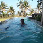 refreshing swim in rimflow pool