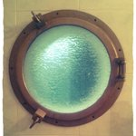 The pretty porthole onto balcony in the Junior Suite (#183) on the top floor!