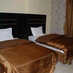 غرفة 2 سرير داخل شقة بالارجوانة