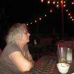 Enjoying a great meal under the stars and the banana/palm trees