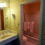Vanity area looking into small bathroom.