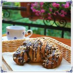 Croissant with milk chocolate and walnuts