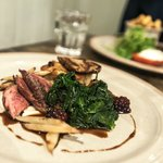 Pan-fried Mallard breast, seared liver, Iberico bacon, thyme & potato cake, curly kale & salsify