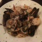 Seafood combination over linguine in white wine sauce