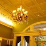 High ceiling & chandelier in dining room