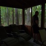 screened in back porch with lots of relaxing chairs