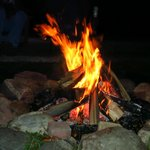 Dave the inn keeper lays out a fire for guests by the dock.
