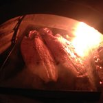 Our trout roasting in their clay oven