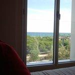Вид с кровати на море