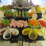 Breakfast buffet offers a variety of artfully arranged fruits, veggies, cereals, eggs, and more.